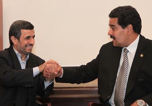 Mahmoud Ahmadinejad, Nicolas Maduro / AP