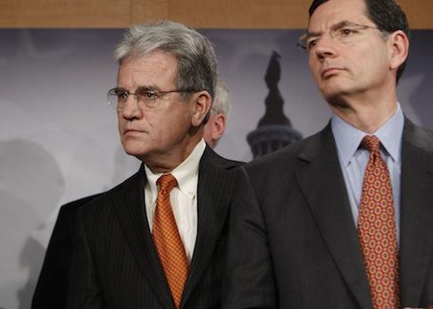 Sen. Tom Coburn, (R., Okla.) with Sen. John Barrasso, (R., Wyo.) / AP