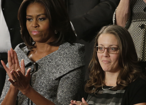 First lady Michelle Obama with State of the Union guest Rebekah Erler / AP