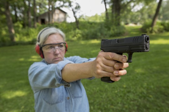 Woman with gun / AP