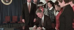 'Chris Jennings (second from left) appears at a bill singing with President Bill Clinton / AP' from the web at 'http://s2.freebeacon.com/up/2015/11/Chris-Jennings-260x105.jpg'