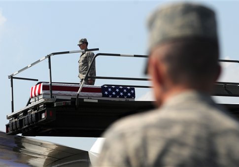 A transfer case containing the remains of Army 1st Lt. Michael L. Runyan sits on a loader Saturday, July 24, 2010 at Dover Air Force Base, Del. Runyan died in Iraq of injuries sustained when insurgents attacked his convoy vehicle with an improvised explosive / AP