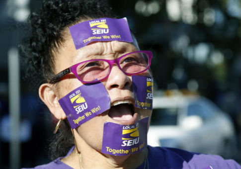 A protestor at an SEIU rally in Los Angeles, California / AP