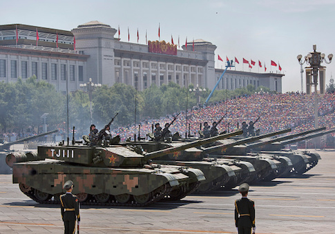 Chinese soldiers ride in tanks as they pass in front of Tiananmen Square and the Forbidden City during a military parade