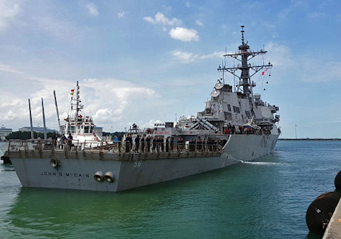Guided-missile destroyer USS John S. McCain (DDG 56) arrives pier side at Changi Naval Base, Republic of Singapore following a collision